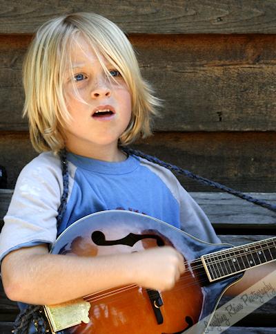 My new little friend, D, the mandolin player
